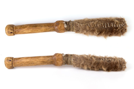 Beautiful copy of old vintage beater drumstick isolated on white