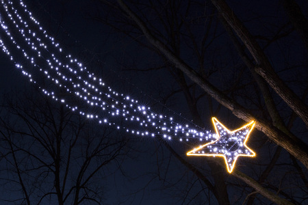 Christmas garland light bulbs falling star in the night Stock Photo - 94498050