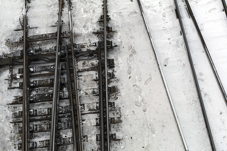 Winter top view on railway tracks and switch in snow background