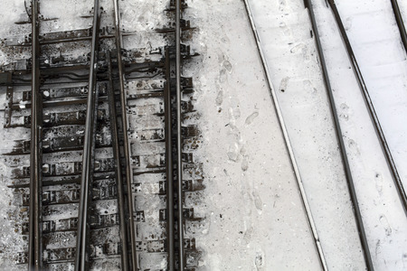 Winter top view on railway tracks and switch in snow background Stock Photo - 94468974