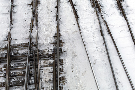 Winter top view on railway tracks and switch in snow background Stock Photo - 94267023