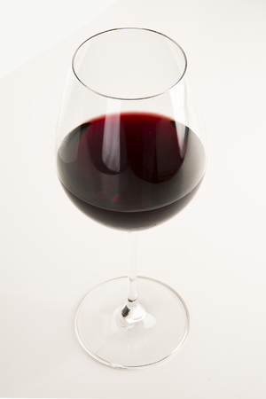 Glass of red wine isolated on white Stock Photo - 94815352