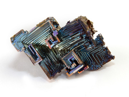 Rainbow colorful mineral bismuth closeup macro on white