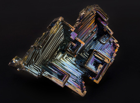 Shiny colorful mineral bismuth on a dark background Stock Photo - 95456487