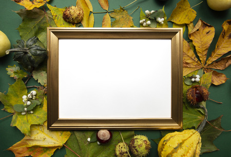 Green yellow autumn harvest around gold blank frame top view background Stock Photo