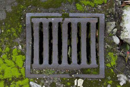 Beautiful aged vintage city sewer grate road drainage top view