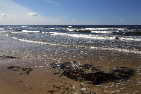 Baltic Sea shore on cold windy sunny afternoon in April Stock Photo