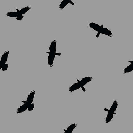 Flying crows in the dark grey sky seamless pattern