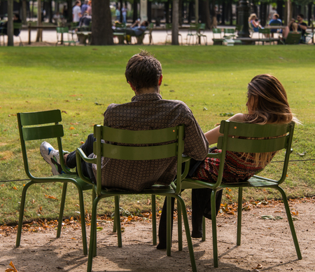 Couple sitting in the park in Paris