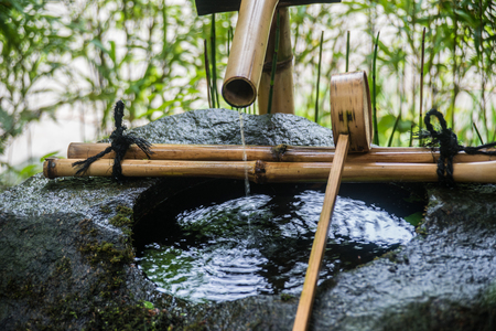 Temizuya purification rite Fountain stone and bamboo for hand and face washing Stock Photo