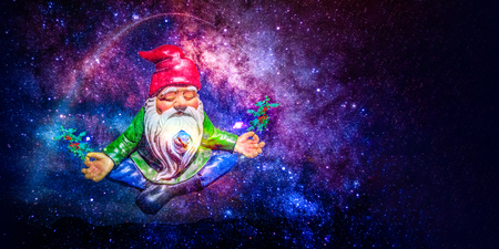 santa dwarf meditating in space with holly holding branches in his hand