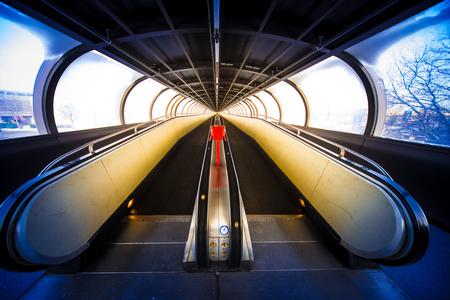 Travelator moving walkway tunnel dynamic perspective, fair Messe Düsseldorf