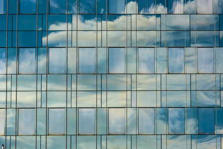 Cloud reflection in building window architecture pattern