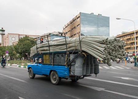 Overloaded truck with tubes in Teheran