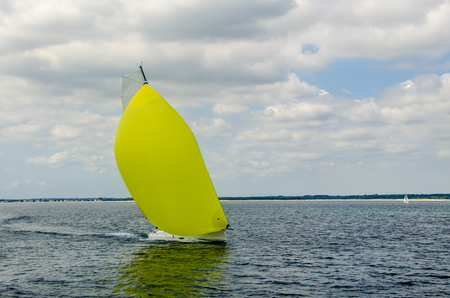 Modern Sailing boat white sails yellow spinnaker Banque d'images