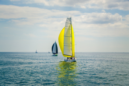 Modern Sailing boat white sails yellow spinnaker Éditoriale