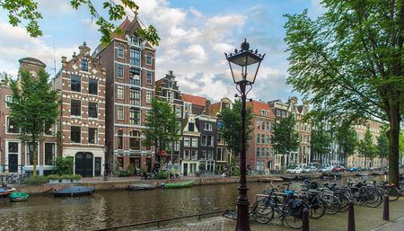 Amsterdam romantic street view blue cloudy sky 新聞圖片