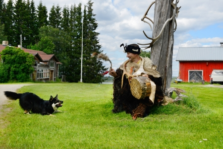 Sami shaman and his assistant - dog  Finnish Lapland