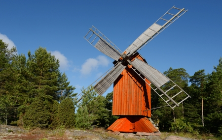 red wooden windmill photo