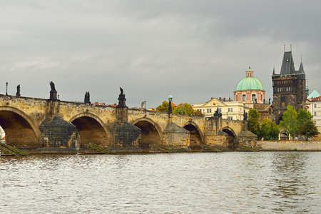 Charles Bridge is famous historic bridge that crosses Vltava river. Its construction started in 1357 under auspices of King Charles IV