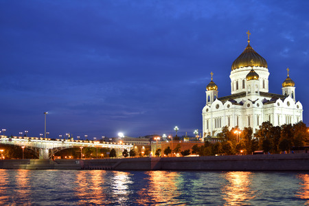 Beautiful orthodox Cathedral of Christ Saviour illuminated at dusk on bank of Moscow river. It is tallest Orthodox church in world photo