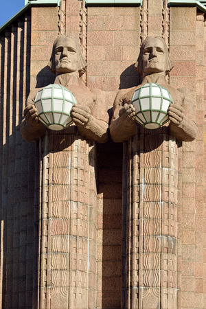 widely: Statues holding the spherical lamps at the Helsinki Central railway station is a widely recognised landmark in Kluuvi, part of central Helsinki Stock Photo
