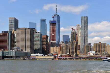 Financial District of Lower Manhattan viewed from Brooklyn Bridge Park Pier. New York City, US