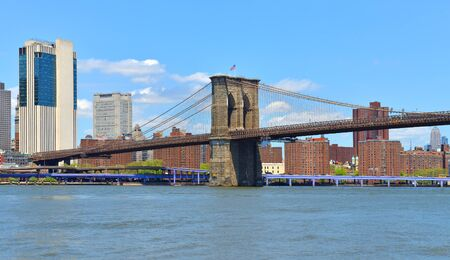 Famous Brooklyn Bridge (1883), hybrid cable-stayed, suspension bridge in New York City. USA. Bright sunny day