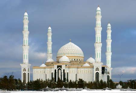 Hazrat Sultan Mosque against background of dark clouds in winter Stock Photo