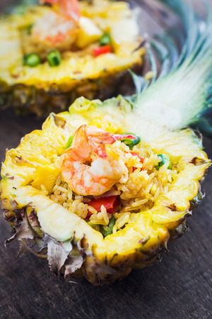Pineapple fried rice shrimp on wooden table