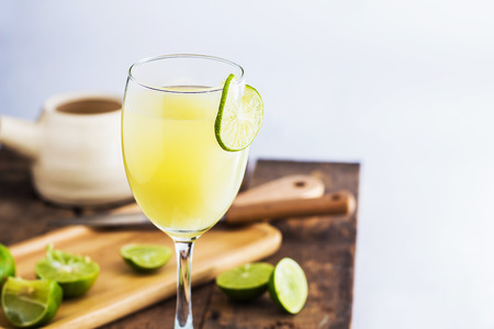 lime juice: Lime Juice on wooden background