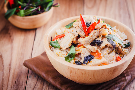 stir up: Close up Rice topped with stir fried  pork and basil Stock Photo