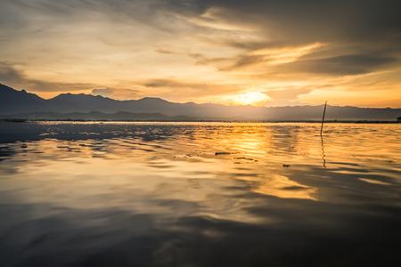 garish: sunset time, at Kwan Phayao lake, Phayao province, Thailand Stock Photo