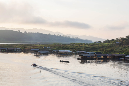 house float on water: The lake at morning fog in Sangkhla Buri, Thailand Stock Photo