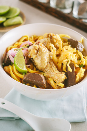 soi: Curried Noodle Soup Khao soi with coconut milk, Northern Thai cuisine. Stock Photo