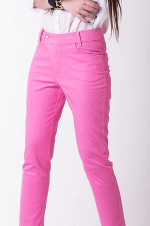 trousers: Pink women trousers,Focus on trousers. Stock Photo