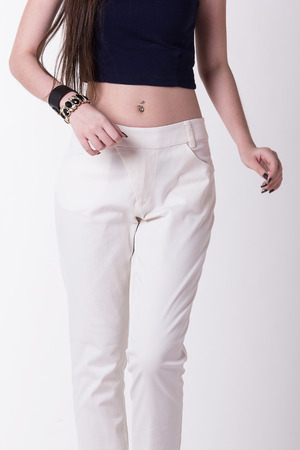 trousers: White women trousers,Focus on trousers.