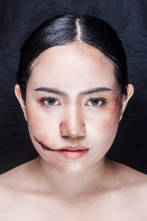 beauty shot: Women with horror make up. in the studio on a black background. beauty shot