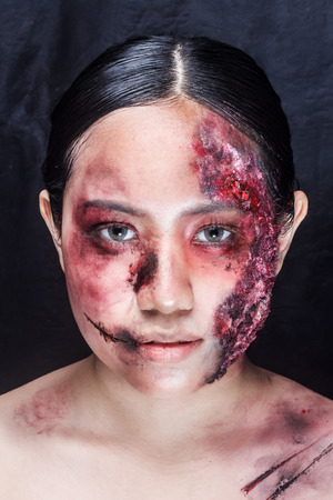 otherworldly: Women with horror make up. in the studio on a black background. beauty shot