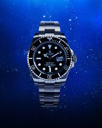 Bangkok, Thailand -  March 29, 2016: Luxurious wrist watch from Rolex for men on water background. Studio shot in Bangkok, Thailand. Éditoriale