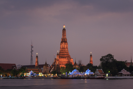 BANGKOK, THAILAND - DECEMBER  05, 2013 - Sunset at Wat Arun temple (Temple of Dawn) locally known as Wat Chaeng, is situated on the west (Thonburi) bank of the Chao Phraya River Read