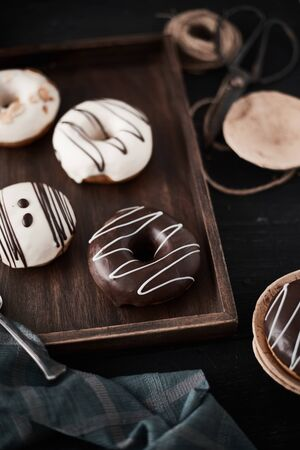 Different donuts on wooden table.