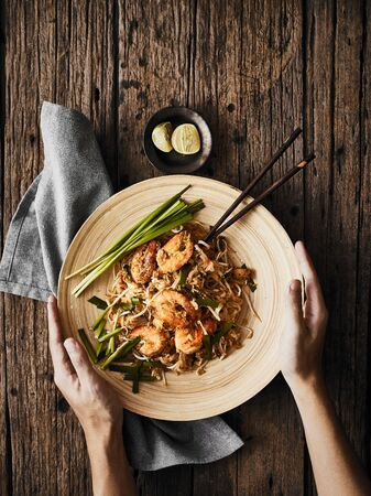 Pad Thai noodles with shrimps and vegetables.