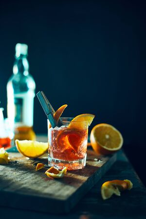 Alcoholic cocktail with orange peel and ice. Reklamní fotografie