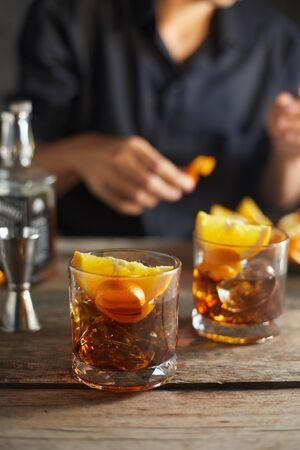 Tasty alcoholic old fashioned cocktail with orange slice Reklamní fotografie