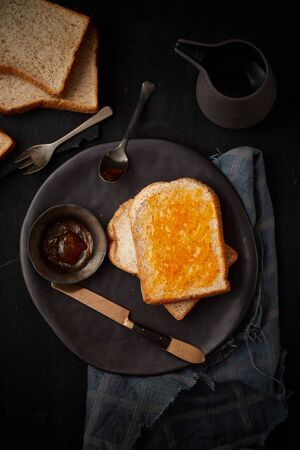 Delicious toasts with sweet jams on wooden background.