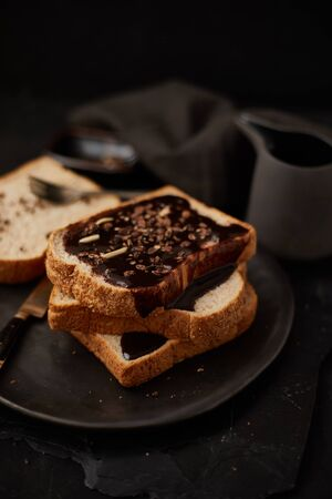Chocolate cream on a slice of Toast.