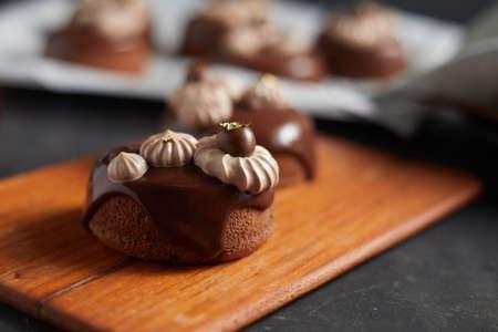 Tasty homemade chocolate cake on dark background.