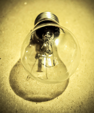 isolated glowing old fashioned bulb. light bulb on a colored background