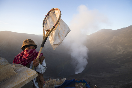 appease: Mount Bromo Surabaya Indonesia-August 1,2015 :  Unidentified people preparing for Kasada ritual at Tengger, Semeru Mount Bromo.An ancient ritual is to appease the spirit of the mountain. Editorial